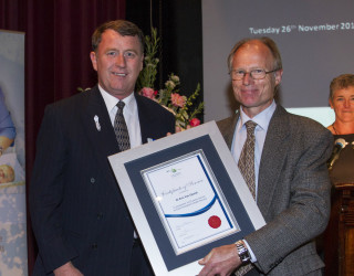 2013 : Dr Eric Van Opstal is presented with his 20 Year Service Award in 2013 by Board member, Don Cole