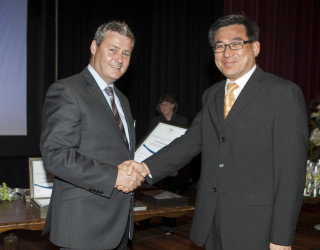 2012 : Dr C.S. Wong is presented with an Advanced Diploma of Obstetrics by past Board President, Graeme Foster