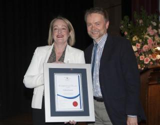 2014 : Dr Michael Connellan receives his 20 Year Service Award from past Board President, Louise Staley