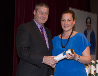 Nicki Carlyle receives her Bachelor of Nursing Certificate from past EGHS Board President, Graeme Foster